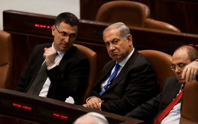 Prime Minister Benjamin Netanyahu (C) and then interior minister Gideon Sa'ar (L) seen at the Knesset on July 9, 2013. (Flash 90)