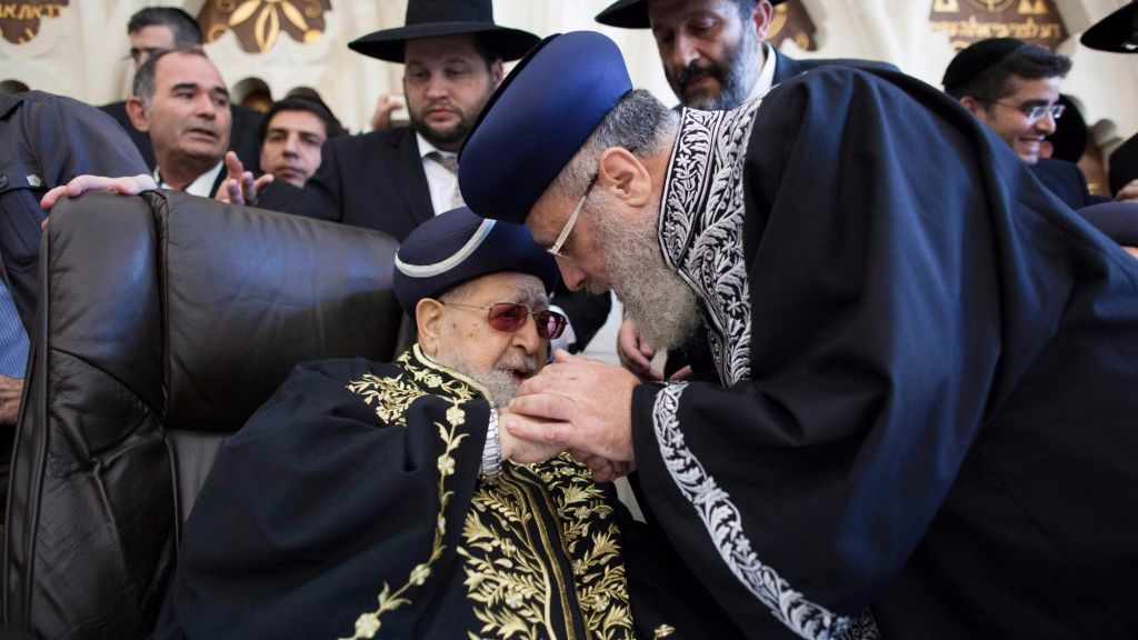 Shas spiritual leader Rabbi Ovadia Yosef seen with his son Chief Rabbi Yitzhak Yosef during a ceremony inaugurating the latter as the Sephardic chief rabbi of Israel at the at the Rabban Yohanan Ben Zakai Synagogue in Jerusalem old city on September 16, 2013, (Yonatan Sindel/Flash90)