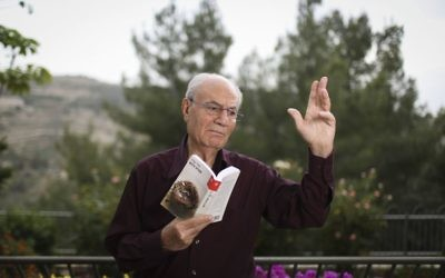 Portrait of Israeli author, Eli Amir, with his recent book, in his home in Jerusalem, on May 5, 2014. Eli Amir's book, 'The Dove Flyer' (or, 'Farewell Baghdad'), about a Zionist family living in Baghdad, was adapted to a movie that was recently released to the big screen. (Hadas Parush/Flash 90.)