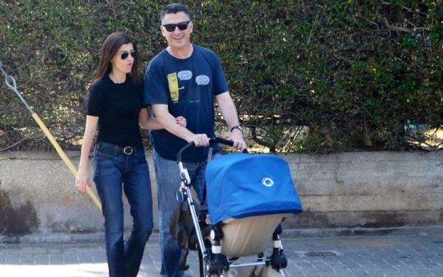Gideon Saar seen with his wife Geula Even and their son, in Tel Aviv, a day after Saar announced that he was resigning from politics. September 18, 2014. (Photo by FLASH90)