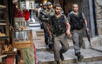 Illustrative: Border Police walk through Jerusalem's Old City on October 11, 2015. (Hadas Parush/Flash90)