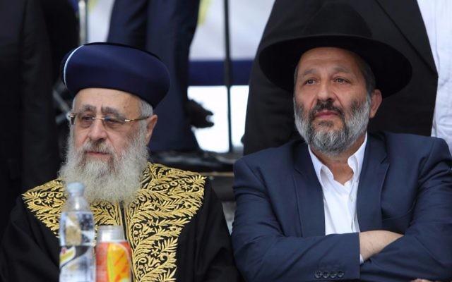Interior Minister Aryeh Deri, right, and Sephardi Chief Rabbi Yitzhak Yosef, left, on September 19, 2016. (Yaakov Naumi/Flash90)