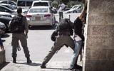 Illustrative: A Border Police officer frisks a Palestinian man in front of Damascus Gate in Jerusalem's Old City on September 20, 2016. (Sebi Berens/Flash90)