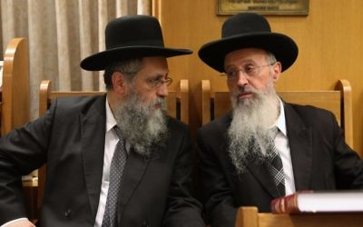 Rabbi Avraham Yosef (r) and Rabbi David Yosef attend a ceremony in memory of Rabbi Ovadia Yosef in Jerusalem on November 3, 2016. (Yaakov Cohen/Flash90)