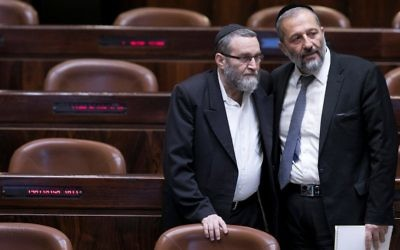 Interior Minister Aryeh Deri (R) speaks with United Torah Judaism MK Moshe Gafni at the Knesset on November 7, 2016. (Yonatan Sindel/Flash90)
