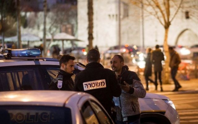 A man gets checked by police near the Damascus Gate in Jerusalem on January 30, 2017. (Sebi Berens/Flash90)