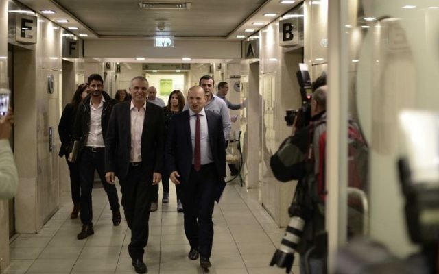 Finance Minister Moshe Kahlon, left, and Education Minister Naftali Bennett arrive at a press conference at the Education Ministry on March 19, 2017. (Tomer Neuberg/Flash90)