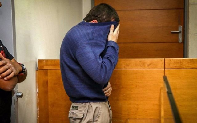 A man brought for a court hearing at the Rishon Lezion Magistrate's Court, under suspicion of Issuing fake bomb threats against Jewish institutions around the world, on March 23, 2017.  (Flash90)