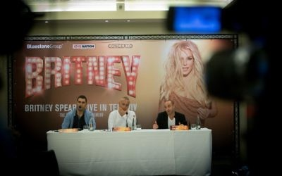 (L-R) Shay Mor Yosef, producer Udi Applebaum and Guy Basar at a press conference in Tel Aviv, officially announcing the upcoming Britney Spears concert, which will be held in Tel Aviv in July. March 28, 2017. (Miriam Alster/FLASH90)