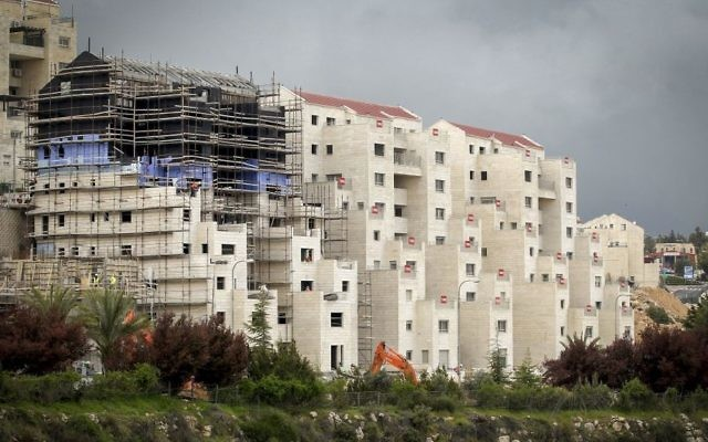 Construction in the Israeli settlement of Kiryat Arba, near the West Bank city of Hebron, on April 2, 2017. (Wisam Hashlamoun/Flash90)