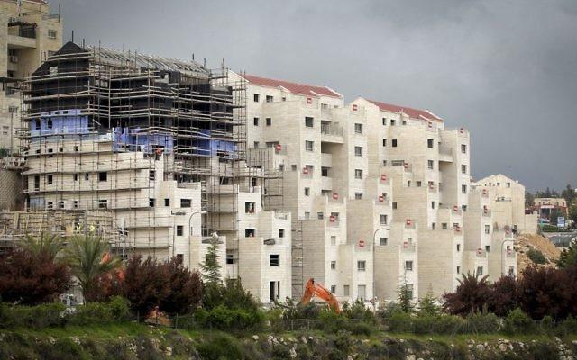 Construction in the Israeli settlement of Kiryat Arba, near the West Bank city of Hebron, on April 2, 2017. (Wisam Hashlamoun/Flash90)