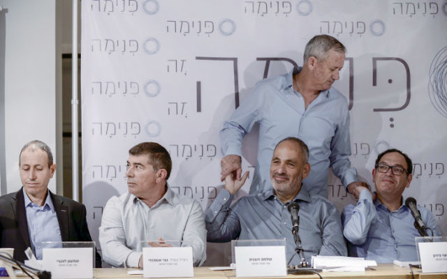 "Mayor of Acre Shimon Lankri, Former IDF chief of staff Gabi Ashkenazi (2L), Shlomo Dovrat, former IDF chief of staff Benny Gantz (standing) and former education minister Shai Piron at a press conference for the new social movement ""Pnima,"" in Lod, on April 3, 2017. (Tomer Neuberg/FLASH90)"