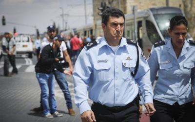 Jerusalem Police Chief Deputy Commissioner Yoram Halevi arrives at the scene of a stabbing attack on the city's light rail line near IDF Square in Jerusalem on April 14, 2017. (Yonatan Sindel/Flash90)