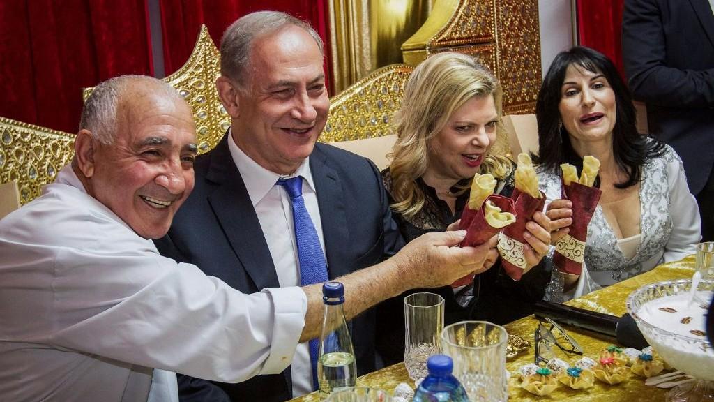 Prime Minister Benjamin Netanyau and his wife Sara attend a Mimouna celebration in Hadera on April 17, 2017. (Ido Erez/Pool/Flash90)