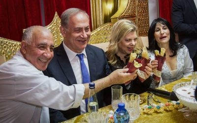 Prime Minister Benjamin Netanyahu and his wife Sara attend the Jewish Moroccan celebration of Mimouna, in Hadera on April 17, 2017. (Ido Erez/POOL)