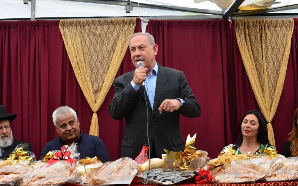 Prime Minister Benjamin Netanyau attends the Jewish Moroccan celebration of Mimouna, in the Negev city of Dimona on April 18, 2017. (Kobi Gideon / GPO)