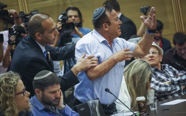 A man reacts at the State Control committee meeting in the Israeli parliament during a discussion about the Operation Protective Edge report, on April 19, 2017. (Hadas Parush/Flash90)