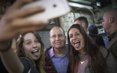 "Former defense minister Moshe ""Boogie"" Ya'alon visits the Mahane Yehuda Market, in Jerusalem, on Friday, April 25, 2017. (Yonatan Sindel/Flash90)"