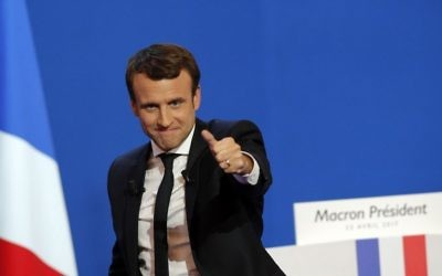 French centrist presidential candidate Emmanuel Macron thumbs up as he addresses his supporters at his election day headquarters in Paris, Sunday April 23, 2017. (AP/Christophe Ena)