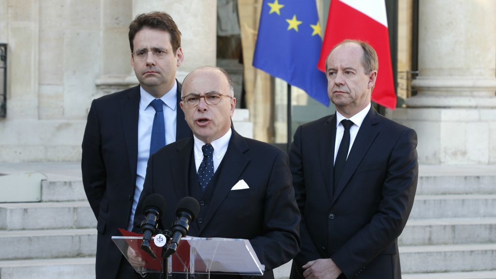 France's Interior Minister Matthias Fekl, left, Justice minister Jean-Jacques Urvoas, right, and Prime Minister Bernard Cazeneuve speak to the media after a defense and security council meeting at the Elysee Palace, in Paris, Friday, April 21, 2017. (AP Photo/Christophe Ena)