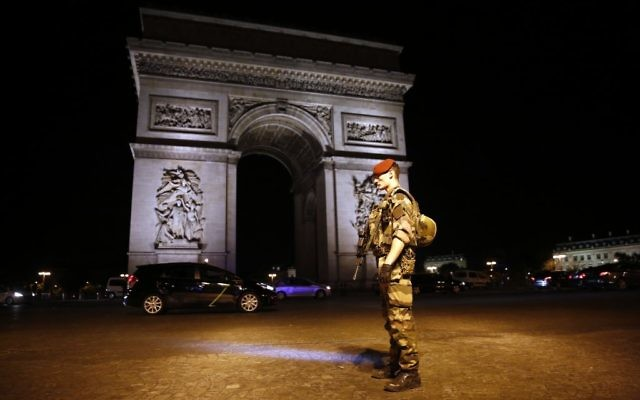 A soldier stands guard near the Arc of Triomphe at the top of the Champs-Elysees avenue in Paris, after a fatal shooting on April 20, 2017. (AP/Kamil Zihnioglu)