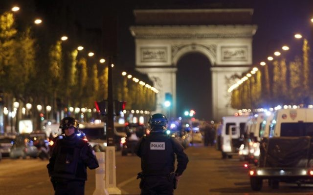 Police seal off the Champs-Elysees avenue in Paris, France, after a fatal shooting in which a police officer was killed along with an attacker, Thursday, April 20, 2017. (AP Photo/Thibault Camus)
