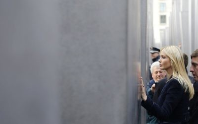 Ivanka Trump, daughter and adviser of US President Donald Trump, touches a slab when visiting the Memorial to the Murdered Jews of Europe after attending the W20 Summit in Berlin Tuesday, April 25, 2017. (AP Photo/Ferdinand Ostrop)
