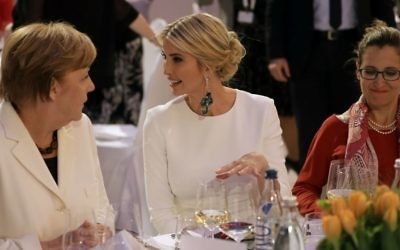 In this Tuesday, April 25 photo, Ivanka Trump, center, daughter and adviser to US President Donald Trump, and German Chancellor Angela Merkel, left, attend a dinner after they participated in the W20 Summit in Berlin. (AP Photo/Michael Sohn, pool)