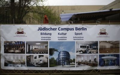A poster with the planned new Jewish campus is displayed at the Chabad Educational Centre in Berlin, Germany, April 3, 2017. (AP Photo/Markus Schreiber)