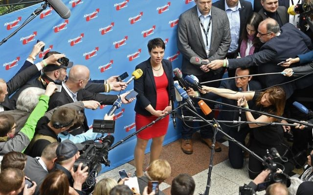 Co-leader Frauke Petry talks to the media at the party convention of Germany's nationalist party AfD (Alternative for Germany) in Cologne, Germany, Saturday, April 22, 2017.(AP Photo/Martin Meissner)