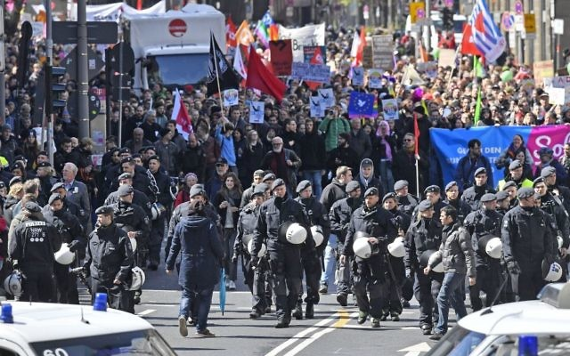 Police secures a protest march against the party convention of Germany's nationalist party AfD (Alternative for Germany) in Cologne, Germany, Saturday, April 22, 2017.  (AP Photo/Martin Meissner)