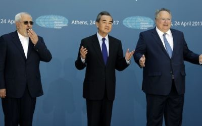 "Greek Foreign Minister Nikos Kotzias, right, and his Iranian counterpart Mohammad Javad Zarif, left, and Chinese Foreign Minister Wang Yi gesture as they pose for the photographers as they attend the ""Ancient Civilizations Forum"" (ACForum) at Zappeio Conference Hall in Athens, April 24, 2017.  (AP Photo/Thanassis Stavrakis)"