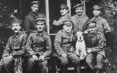 Adolf Hitler (seated, far left) posed with fellow soldiers during their World War I service for Germany (Public domain)