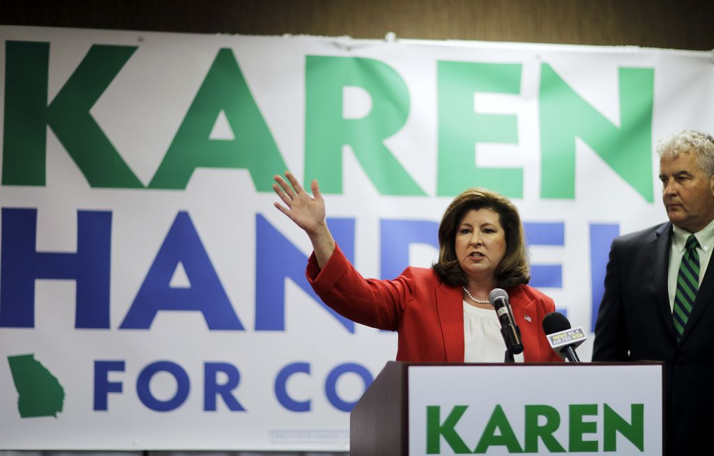 Republican candidate for Georgia's 6th Congressional seat Karen Handel updates supporters with her husband Steve on early results at an election night watch party in Roswell, Georgia, April 18, 2017. (AP Photo/David Goldman)
