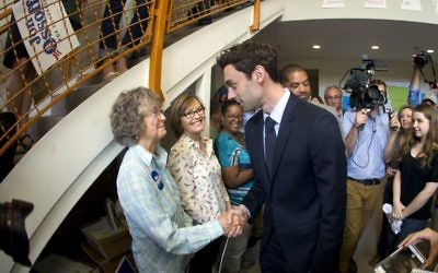 Democratic candidate for Georgia's 6th Congressional seat Jon Ossoff greets supporters at a campaign field office Tuesday, April 18, 2017. (AP Photo/John Bazemore)