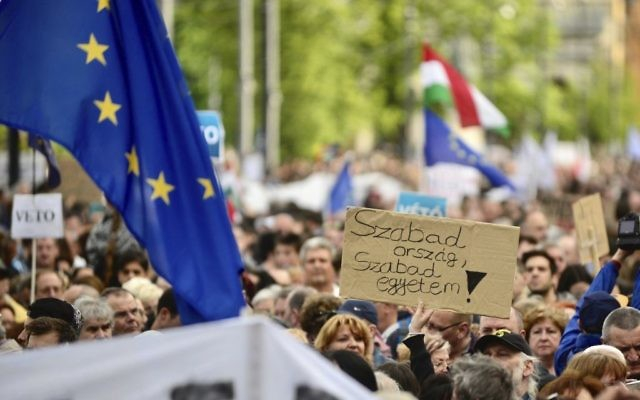 "Demonstrators hold a placard reading ""Free country, free university!"" as they protest against the efforts to close Central European University, as part of Prime Minister Viktor Orban's plan to transform Hungary into an ""illiberal state"" in Budapest, Hungary, Sunday, Apr. 9, 2017. (Janos Marjai/MTI via AP)"