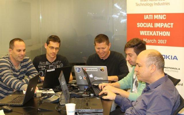 Team at work at IATI's Social Impact Weekathon (IATI)
