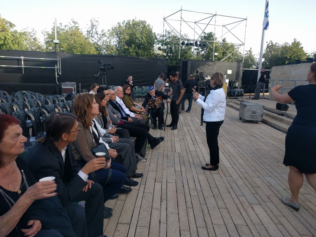 This year's torch lighters for the Yad Vashem opening Holocaust Remembrance Day ceremony receive instructions at the dress rehearsal. (Yaakov Schwartz/ Times of Israel)