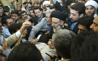 Iranian presidential hopeful Ebrahim Raisi, center, arrives at Houri mosque to deliver a speech in southern Tehran, Iran, Monday, April 10, 2017. (AP Photo/Vahid Salemi)