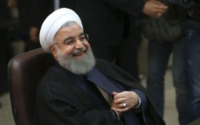 Iranian President Hassan Rouhani smiles as he registers his candidacy for the May 19 presidential elections, in Tehran, Iran, on April 14, 2017. (AP/Vahid Salemi, File)