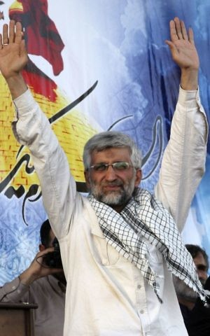 In this file photo taken on Wednesday, June 12, 2013, Iranian presidential candidate Saeed Jalili waves to his supporters in a campaign rally in Tehran, Iran. (AP Photo/Vahid Salemi, File)