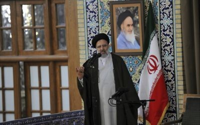 In this March 21, 2017 photo, released by an official website of the office of the Iranian supreme leader, Ebrahim Raisi speaks prior to speech of Supreme Leader Ayatollah Ali Khamenei in the northeastern city of Mashhad, Iran. Iran's official IRNA news agency reported Sunday April 9, 2017, that hard-line cleric Raisi, the head of the Imam Reza charity foundation and close ally of Iran's supreme leader, has announced he will run in the May presidential election.  (Office of the Iranian Supreme Leader via AP)