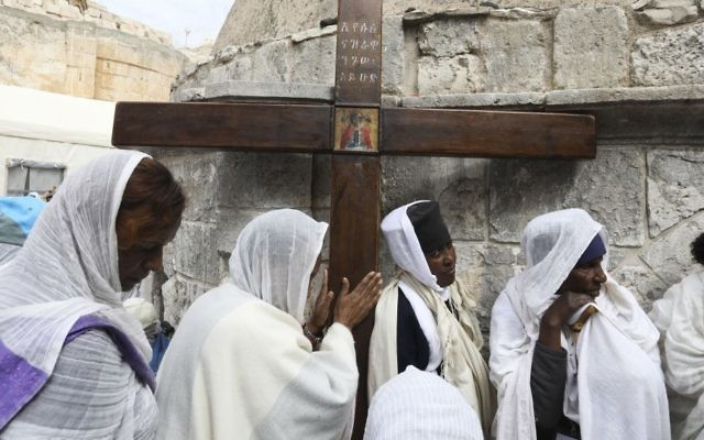 Ethiopian Christian pilgrims attend Good Friday procession in Jerusalem Friday, April 14, 2017. Good Friday is a Christian holiday which marks the crucifixion of Jesus Christ and his death. (Dan Balilty/AP)