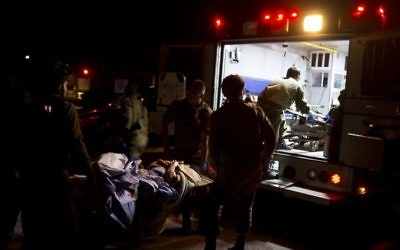 In the Golan Heights, Israeli military medics assist wounded Syrians, April 6, 2017. (AP Photo/Dusan Vranic)