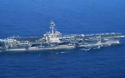 The USS Carl Vinson sails offshore Nagasaki prefecture, southern Japan Saturday, April 29, 2017 (Kyodo News via AP)