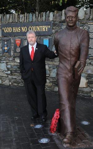 Jerry O'Grady, chairman of the Monsignor O'Flaherty Memorial Society with bronze statue of the Monsignor in Killarney, County Kerry, Ireland. (Courtesy/Don McMonigle)