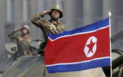 In this Saturday, April 15, 2017, file photo, a North Korean national flag flutters as soldiers in tanks salute to North Korean leader Kim Jong Un during a military parade in Pyongyang, North Korea to celebrate the 105th birth anniversary of Kim Il Sung, the country's late founder and grandfather of the current ruler. (AP Photo/Wong Maye-E, File)