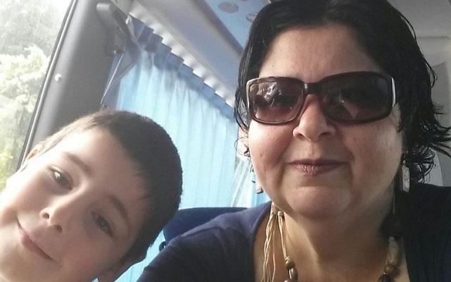Elia Halpern and her son riding the Noa Tnua bus to Tel Aviv, 2016. (Courtesy of Halpern)