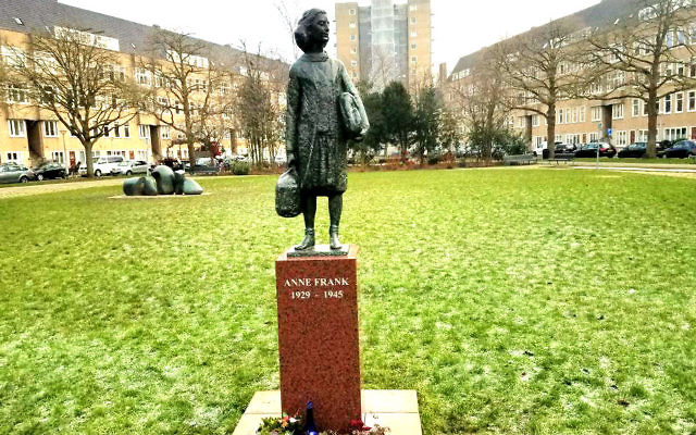 Erected in 2005, a statue of Anne Frank stands close to the Frank family's former apartment in Amsterdam's River Quarter, January 2017 (Matt Lebovic/The Times of Israel)