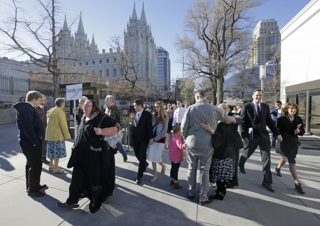 People arrive for the morning session of the two-day Mormon church conference Saturday, April 1, 2017, in Salt Lake City (AP Photo/Rick Bowmer)
